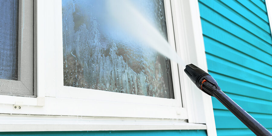 cleaning service washing building facade and window with pressure water. cleaning dirty wall with high pressure water jet. power washing the wall. cleaning the facade of the house. before and after washing